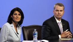 South Carolina Republican candidates for governor Nikki Haley and Gresham Barrett look at a monitor as they are asked questions during a televised debate in Columbia on June 17.