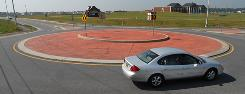A growing number of states and municipalities are looking to replace four-way insersections with roundabouts, like this one in Middletown, Del.