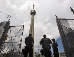 Canadian police guard the perimeter of the CN Tower on Thursday in Toronto, host city to the G-20 summit.