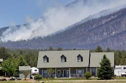 The Schultz fire burns Wednesday north of Flagstaff, Ariz. Residents who were forced to flee their homes Sunday were allowed to return Wednesday morning.