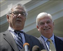 Senate Banking Committee Chairman Sen. Christopher Dodd, D-Conn., right, and House Financial Services Committee Chairman Rep. Barney Frank, D-Mass., seen here in May speaking to reporters outside the White House, were part of the negotiating team that helped completed a sweeping overhaul of banking regulations.