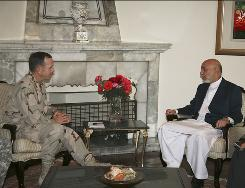In this photograph released by the Afghan President's Office, Afghan President Hamid Karzai, right, meets the U.S. military's top officer Adm. Mike Mullen in Kabul Saturday.