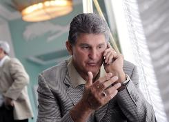 West Virginia Gov. Joe Manchin speaks on the phone about the death of Sen. Robert C. Byrd on Monday. The governor's appointee would serve through 2012.