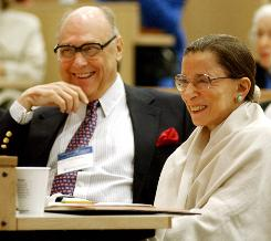 Supreme Court Justice Ruth Bader Ginsburg shares a laugh with her husband, Martin, in 2003, as they listen to Justice Stephen Breyer speak at Columbia Law School at an event marking the 10th anniversary of Ginsburg's appointment to the bench.