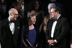 Martin Ginsburg and his wife, Supreme Court Justice Ruth Bader Ginsburg, and Supreme Court Justice Antonin Scalia are seen onstage after the Washington National Opera opening night performance of the Strauss opera Ariadne auf Naxos in 2009.