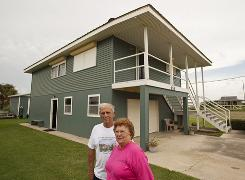 Leo Guidroz, with wife Dolores at their home on Grand Isle, fears they may never be able to come back to their home if an oil-tainted hurricane hits. They have rebuilt twice after hurricanes.