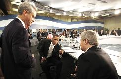 White House chief of staff Rahm Emanuel, left, listens as President Obama talks with Canadian Prime Minister Stephen Harper, right, during the opening plenary session of the G-20 Summit in Toronto on Sunday.