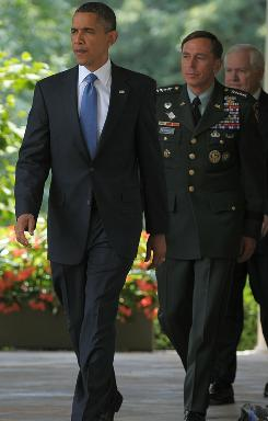 President Obama, General David Petraeus and Defense Secretary Robert Gates make their way through the Colonnade for Obama to make a statement in the Rose Garden on June 23. Most Americans approve of President Obama's decision to oust Gen. Stanley McChrystal as commander of U.S. forces in Afghanistan.