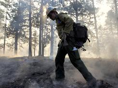 John Meyer of the Boise Hotshots works the Schultz Fire line June 21 in Flagstaff, Ariz. More than 300 firefighters are battling the northern Arizona blaze.
