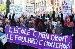 """Women in Brussels holding a sign that reads """"School is my right  the scarf is my choice"""" protest a school ban on head scarves in March."""