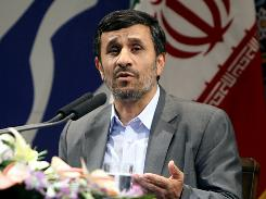 "Iranian President Mahmoud Ahmadinejad speaks during a news conference in Tehran on Monday, saying that Iran will ""discipline"" the West by holding off talks with world powers over Tehran's nuclear program until the end of August."
