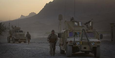 Marines from Fox Company walk past their Humvees as they set out from their base in Farah province in southern Afghanistan on Sept. 22, 2009.