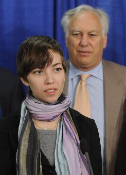 Organ recipient Julianne Willie Brodsky speaks at a news conference April 27 about legislation proposed by her father, Assemblyman Richard Brodsky, right.