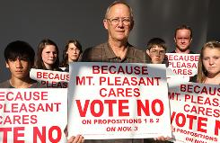 Waylon Moore, center, and members of Highland Park Baptist Church in Mount Pleasant, Texas, show their opposition to a referendum that would ease restrictions on alcohol sales.