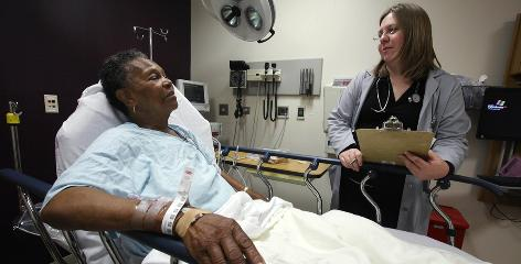 Dr. Rebecca Parker talks to 74-year-old patient Charlene Ladner in the emergency room of Chicago's Advocate Trinity Hospital. Emergency rooms, the only choice for patients who can't find care elsewhere, may grow even more crowded and wait times even longer under the nation's new health law if there aren't more primary care doctors.