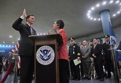 Homeland Security Secretary Janet Napolitano, center, swears in John Pistole as Transportation Security Administration administrator on Thursday Penn Station in New York.