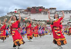 Tibetan performers in traditional costumes perform in Lhasa in June 2008 to mark the Beijing Olympic Games torch relay.