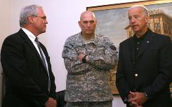 Vice President Biden talks with Gen. Ray Odierno, center, and the U.S. Ambassador to Iraq, Christopher Hill, at the American Embassy in Baghdad, on Saturday.