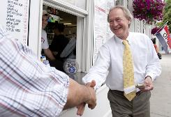 Former Republican Lincoln Chafee, right, greets a supporter at Iggy's Doughboys & Chowder House during his independent run for governor of Rhode Island.