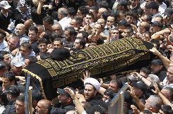 Shiite mourners carry the coffin of Lebanon's top Shiite cleric, who died on Sunday, during his funeral procession in Beirut on Tuesday.