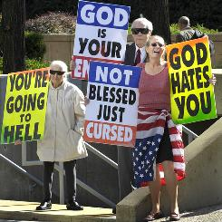 Margie Phelps, left, stands with her husband pastor Fred Phelps and her daughter Margie Phelps during a demonstration outside the federal courthouse in Baltimore in 2007. Members of the Topeka, Kan.-based Westboro Baptist Church demonstrated regarding a suit brought by Albert Snyder, the father of Lance CPL Matthew Snyder, whose funeral the group protested at in Westminster, Md., in 2006.