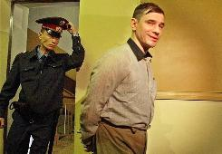 Russian arms control analyst Igor Sutyagin, accused of spying for the United States, enters a courtroom in Moscow on Sept. 2, 2002. A lawyer for Sutyagin said Thursday that he reportedly has been flown to Vienna in what appeared to be the first step of a Russia-U.S. spy swap.