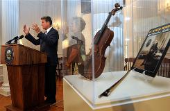West Virginia Gov. Joe Manchin discusses the succession process for Sen. Robert Byrd's seat. At right, Byrd's fiddle and record album.
