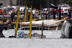 An amphibious craft is salvaged from the Delaware River in Philadelphia Friday after it was knocked over by an oncoming barge Wednesday, spilling 37 people overboard and killing two.