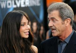 )Actor Mel Gibson and his guest Oksana Grigorieva arrive for the Los Angeles industry screening of 'X-Men Origins-Wolverine' at Grauman's Chinese Theater in Hollywood.