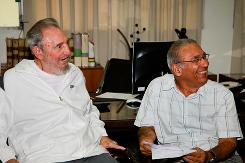 In this image released on Saturday by the state media Cubadebate website, Fidel Castro, left, sits next to an unidentified man during what was said to be a visit Wednesday to the National Center for Scientific Investigation in Havana.