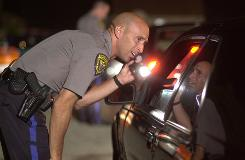 Dover Township, N.J., Patrolman Tim Sysol stops a driver at a DUI checkpoint. The state's Supreme Court ruled Monday that police must explain the state's implied consent law to motorists in a language they understand.