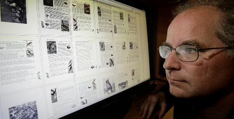 Brewster Kahle, 49, a digital librarian who founded a virtual library called the Internet Archive in 2004, looks at a screen showing scanned books in San Francisco.