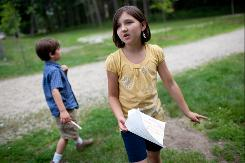 Lily and Nikolai Jirikowic go on a family scavenger hunt at Baxter Woods in Portland, Maine.