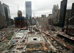 The World Trade Center site is seen from the 20th floor restaurant terrace of the World Center Hotel. A  proposed nearby mosque has drawn controversy.