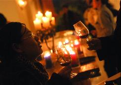 Partygoers enjoy a glass of wine at a Beaujolais party in November 2009 in Beijing. Wealthy Chinese can enjoy Beaujolais Nouveau before it disappears from shelves around the world each autumn.