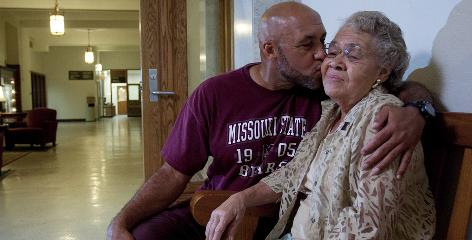 Mary Price Walls receives a kiss from her son, Terry Walls, who is currently a student at Missouri State University, in Carrington Hall. She was among the first African-American applicants to the school in 1950 but was denied access.