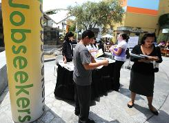 Lines formed June 2 for the second annual Anaheim/Orange County Job Fair in Anaheim, Calif. Unemployment insurance has played a bigger role in this recession than in previous downturns, a USA TODAY analysis finds.