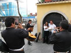 Mariachi musicians play a birthday serenade for customers in Mexico City's Garibaldi Plaza on Tuesday.