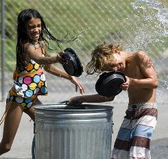Kenadee Carpenter throws water on Trey Dougherty in Knoxville.