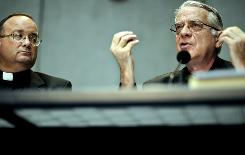 Vatican spokesman the Rev. Federico Lombardi gestures as he gives a news conference with Vatican doctrinal official Monsignor Charles Scicluna on Thursday.