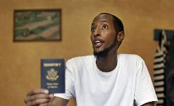 Yahya Wehelie, from Virginia, displays his U.S. passport to an Associated Press reporter in Cairo, Egypt, June 16, 2010.