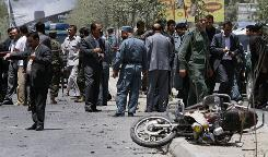 Afghan officials investigate the scene of a suicide bombing in Kabul.