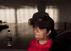 Julia Ojeda, 38, listens to Repeal Coalition group members during a meeting Wednesday in Phoenix on what to do when the immigration law goes into effect July 29. 