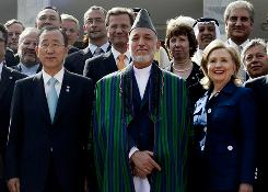 Afghan President Hamid Karzai, center, poses with U.N. Secretary-General Ban Ki Moon, left, and Secretary of State Hillary Clinton after the International Conference on Afghanistan in Kabul on Tuesday.