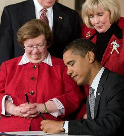 President Obama signs the Lilly Ledbetter Act in the East Room of the White House on Jan. 29, 2009.