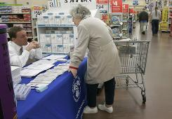 Jane Roswick pauses during her shopping trip to a Little Rock Wal-Mart store at a Social Security Administration information table near the store's pharmacy Feb. 20, 2008.