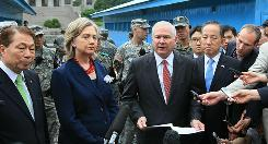 From left, South Korean Foreign Minister Yu Myung Hwan, Secretary of State Hillary Rodham Clinton, Secretary of Defense Robert Gates and South Korean Defense Minister Kim Tae Young speak to reporters at the U.N. truce village building on Wednesday in Panmunjom, South Korea.