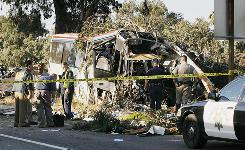 California Highway Patrol officers investigate a Greyhound bus crash in Fresno that killed at least six people and injured many others Thursday.