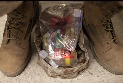 A U.S. Marine keeps a bag full of sample tubes between his feet while taking psychological tests at the Marine Corps Air Ground Combat Center in Twentynine Palms, Calif., on Sept. 29, 2009.