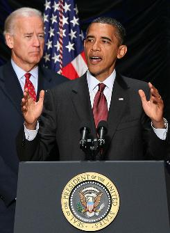 President Obama discusses financial reform prior to signing legislation into law on July 21, as Vice President Biden looks on. Obama has kept a low profile on the 2010 campaign trail thus far, while Biden has been far more visible.